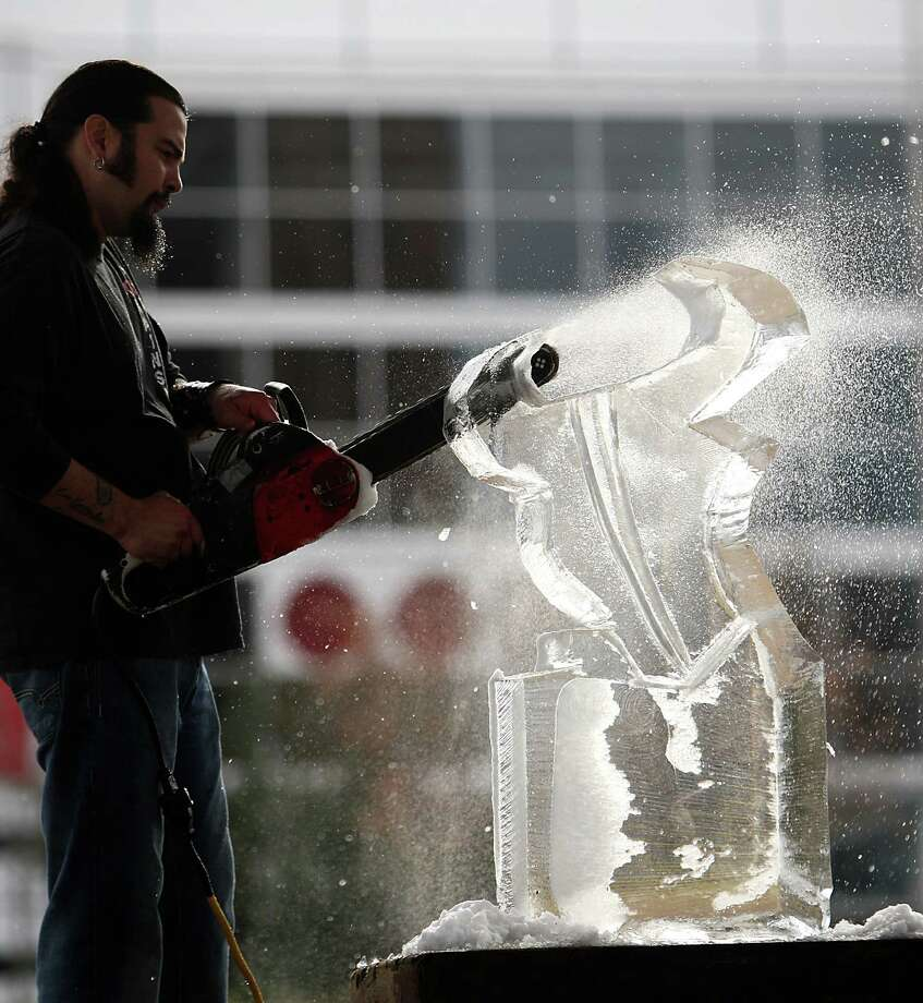 "The Reverend Butter, ""Rolando De La Garza"" carves the Houston Texans mascot, Toro, into a 300-pound piece of ice at Discovery Green, Friday, Jan. 6, 2012. Photo: Karen Warren, Houston Chronicle / © 2012  Houston Chronicle"