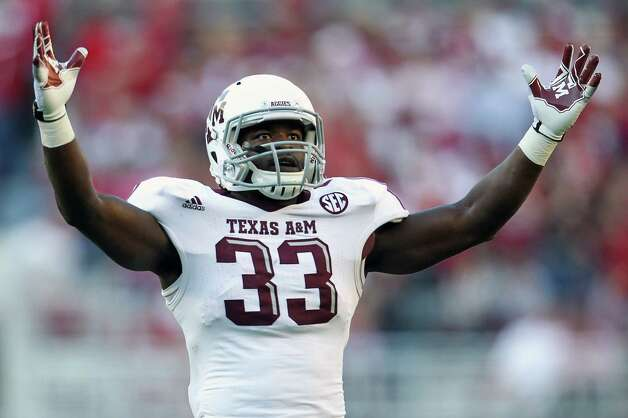 Texas A&M running back Christine Michael (33) celebrates a score against Alabama during a college football game at Bryant-Denny Stadium, Saturday, Nov. 10, 2012, in Tuscaloosa.  ( Karen Warren / Houston Chronicle ) Photo: Karen Warren, Staff / © 2012  Houston Chronicle