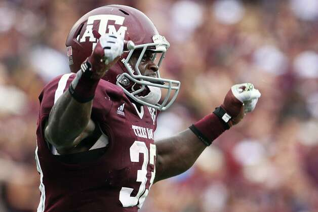 Texas A&M running back Christine Michael (33) celebrates a touchdown against Arkansas during the third quarter of a college football game at Kyle Field, Saturday, Sept. 29, 2012, in College Station.  ( Karen Warren / Houston Chronicle ) Photo: Karen Warren, Staff / © 2012  Houston Chronicle