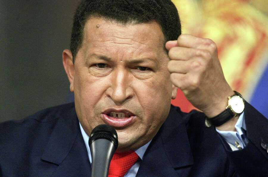 Venezuelan President Hugo Chavez speaks at a press conference in Miraflores Palace December 5, 2006