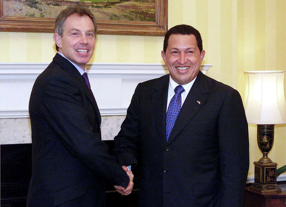 President of Venezuela Hugo Chavez is greeted inside No.10 Downing Street by British Prime Minister Tony Blair, 23 October 2001. Photo: GERRY PENNY, AFP/Getty Images / AFP