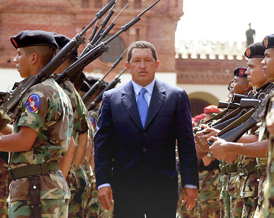 The president of Venezuela, Hugo Chavez, passes soldiers outside fo the Museo Historico Militar in Caracas, 04 February 2002. Photo: HOWARD YANES, AFP/Getty Images / AFP