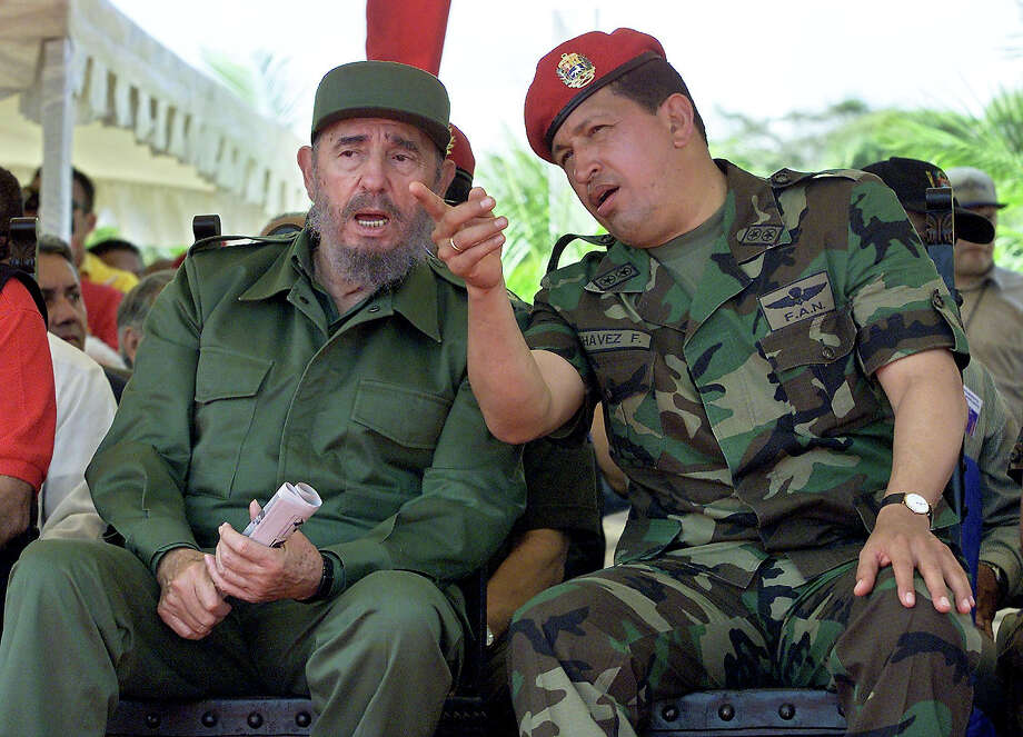Venezuelan President Hugo Chavez confers with Cuban President Fidel Castro in December, 2001 in Pampatar, Venezuela. Photo: ADALBERTO ROQUE, AFP/Getty Images / AFP