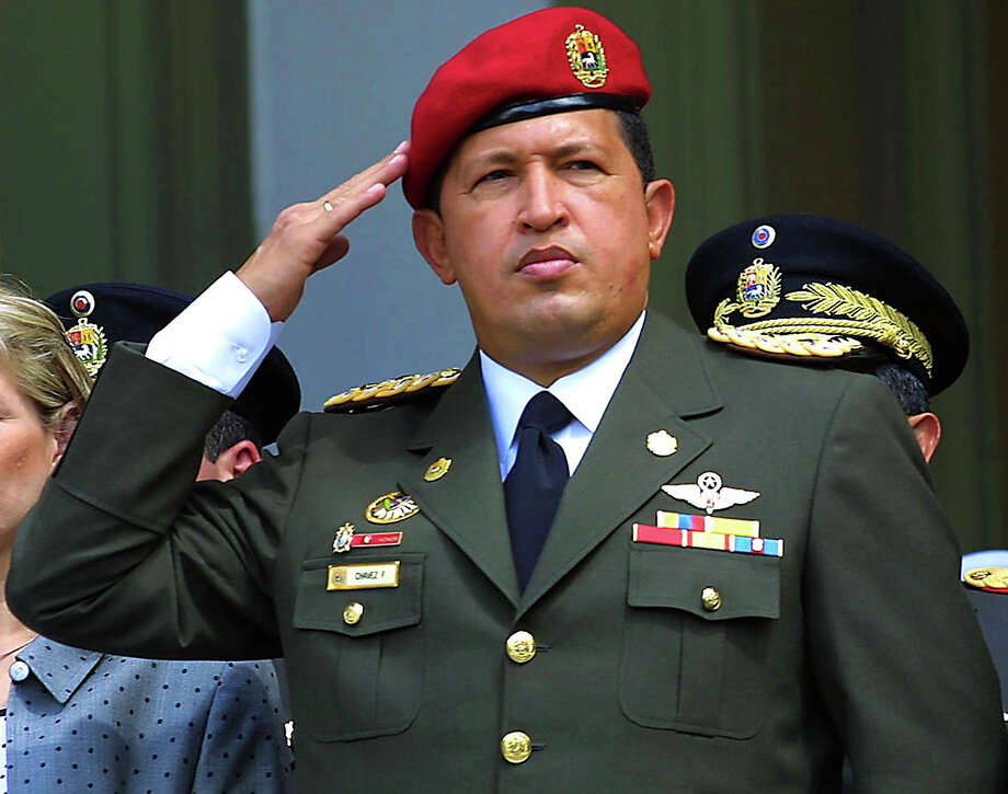 Venezuelan President Hugo Chavez salutes during a ceremony in Caracas in 2001 honoring the 184th anniversary of the birth of the revolutionary peasant leader Ezequiel Zamora. Photo: JUAN BARRET0, AFP/Getty Images / AFP