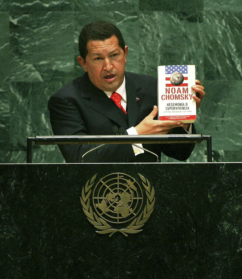 "Venezuelan President Hugo Chavez holds up a book by Noam Chomsky ""Hegemony or Survival: America's Quest for Global Dominance (The American Empire Project)"" while addressing the United Nations General Assembly September 20, 2006 at the UN in New York City. Photo: Spencer Platt, Getty Images / 2006 Getty Images"