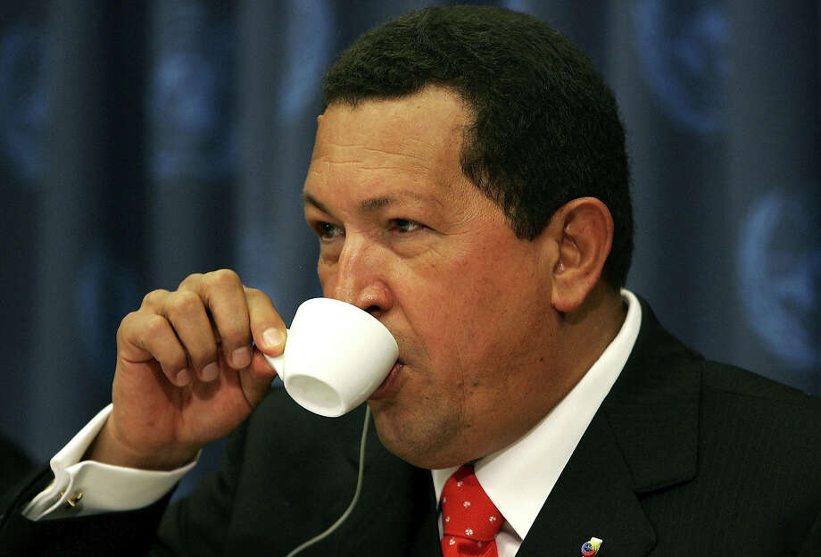 Venezuelan President Hugo Chavez drinks from a cup of coffee during a news conference while attending the United Nations General Assembly September 20, 2006 at the UN in New York City. Photo: Spencer Platt, Getty Images / 2006 Getty Images