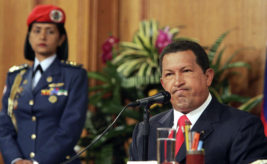 President Hugo Chavez speaks at a press conference in Miraflores Palace November 30, 2006 in Caracas, Venezuela. Photo: Mario Tama, Getty Images / 2006 Getty Images