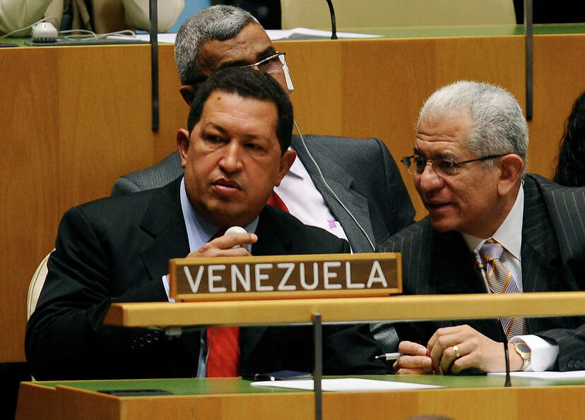 President of Venezuela Hugo Chavez (L) listens to a speaker at the 64th General Assembly at United N