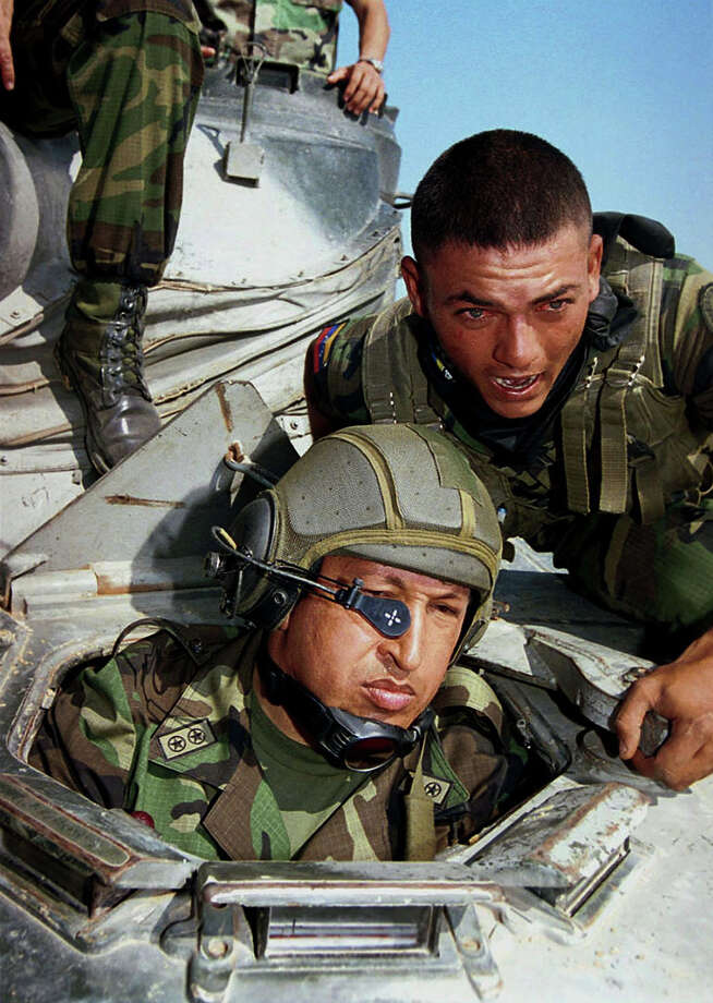 Venezuelan President Hugo Chavez inspects military maneuvers of the national Air Force in 2001. Photo: EGILDA GOMEZ, AFP/Getty Images / 2012 AFP