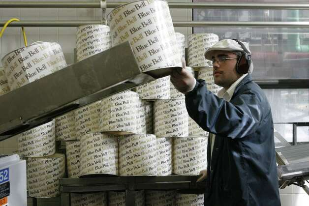 Andrew Wagner puts 3-gallon containers onto a conveyer belt in the Blue Bell plant in Brenham, on Dec. 28, 2006. Photo by Steve Campbell, Chronicle Staff Photo: Steve Campbell, Houston Chronicle / Houston Chronicle