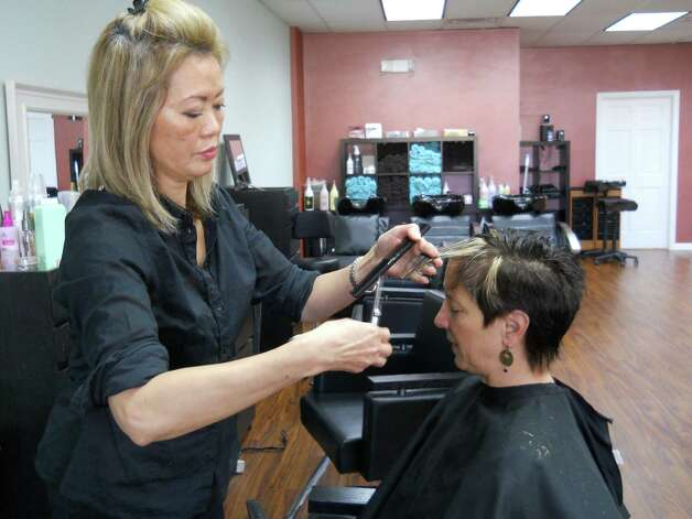 Inson works on Patti's updated cut after finishing her color. Photo: Rebecca Haynes / Healthy Life