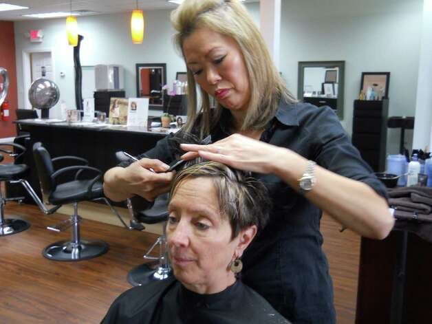 Insoon Neglio of SoHo Salon in Brookfield works on Patti Garland's new cut. Photo: Rebecca Haynes / Healthy Life