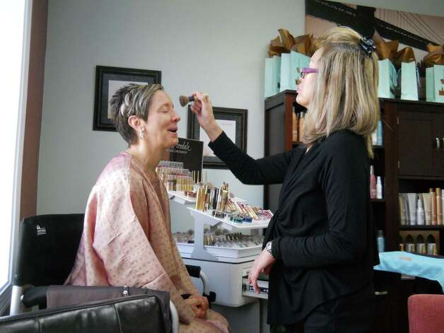 Inson starts on Patti's makeup prior to the photo shoot. Photo: Rebecca Haynes / Healthy Life