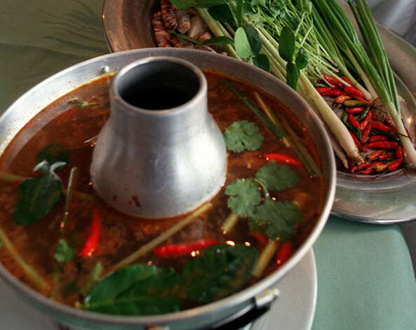 Tom Yum instead of Tom Kai: At a Thai restaurant, few tastes rival the soothing and pungent combination of broth, lemongrass and galangal that make these traditional soups. They're essentially the same soup, but Tom Kai uses coconut milk, while Tom Yum uses only stock. The difference is stunning: A serving of vegetable Tom Yum has 25 calories and virtually no fat, while Tom Kai has 380 calories and 33 grams fat. They both, however, offer a considerable amount of sodium, but Tom Yum still comes out ahead, with 970 milligrams sodium, compared to 1,410 milligrams for Tom Kai.