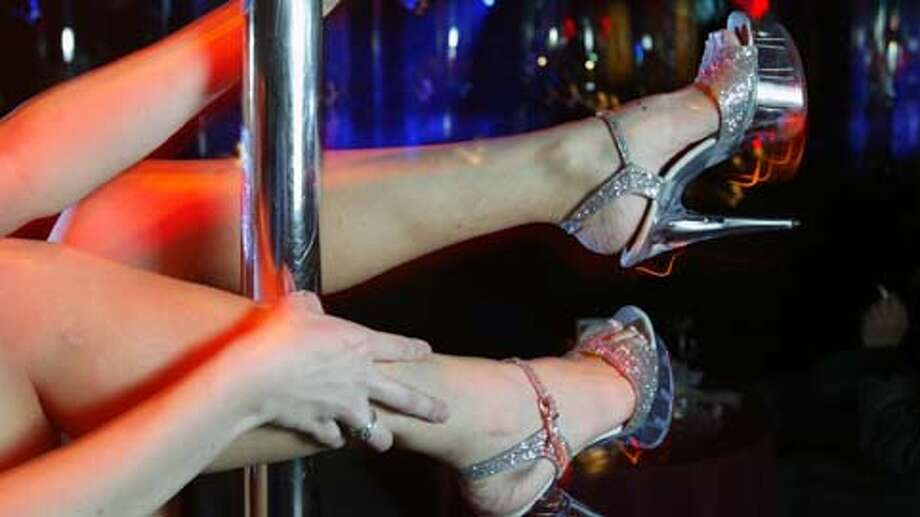"Texas strip clubs that oppose the so-called 'pole tax' FILE -  ""Melanie "" is seen on the smaller stage at Rick's Cabaret in Houston Tuesday Jan. 27, 2004. The club is one of several owned by RCI Hospitality that is opposing the tax. See some of the others ... Photo: Andrew Innerarity, . / Houston Chronicle"