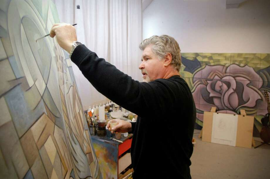 Paul Larson works on his paintings on Friday January 4, 2013 in his studio at the Loft Artist Association in Stamford, Conn. getting ready for a one man show at the at the LAA gallery on February 8. Photo: Dru Nadler / Stamford Advocate Freelance