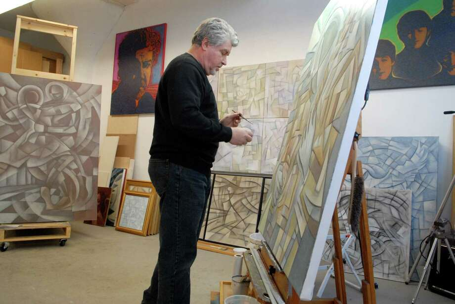 Paul Larson works on his paintings on Friday January 4, 2013 in his studio at the Loft Artist Association in Stamford, Conn. getting ready for a one man show at the at the LAA gallery on February 8 Photo: Dru Nadler / Stamford Advocate Freelance
