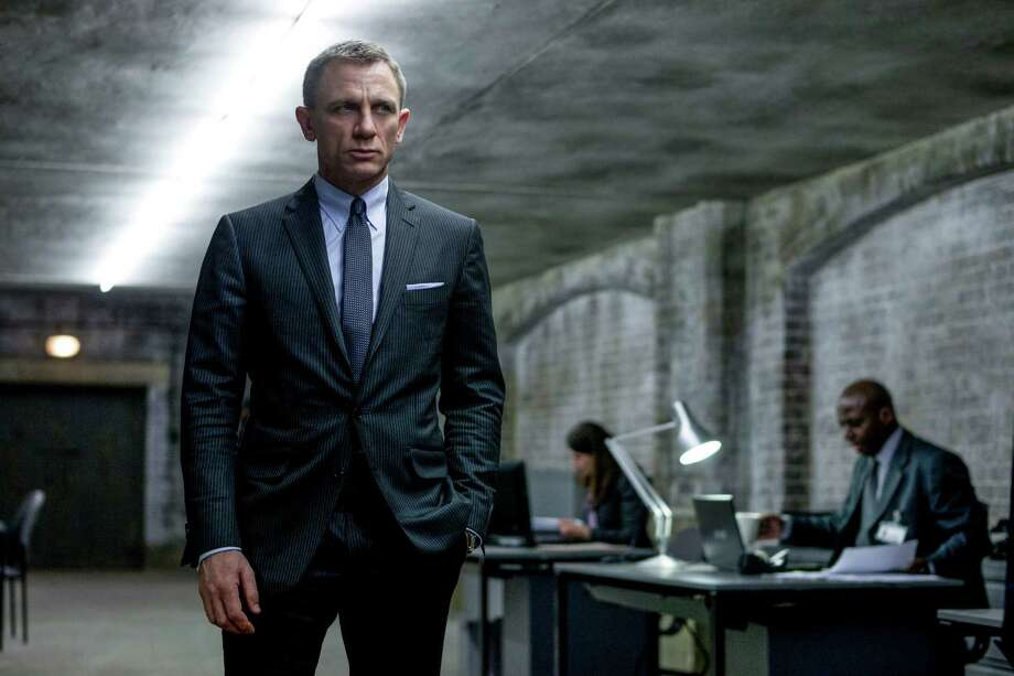 "This film image released by Sony Pictures shows Daniel Craig in a scene from the film ""Skyfall.""  Telecast producers of the 85th Academy Awards say the show will feature a celebration of the 50th anniversary of James Bond. Producers Craig Zadan and Neil Meron announced Friday that the show will pay tribute to the 50th anniversary of the James Bond film franchise, which they describe as ""the longest-running motion picture franchise in history and a beloved global phenomenon."" The Oscars will be presented Feb. 24 at the Dolby Theatre in Los Angeles. (AP Photo/Sony Pictures, Francois Duhamel) Photo: Francois Duhamel"