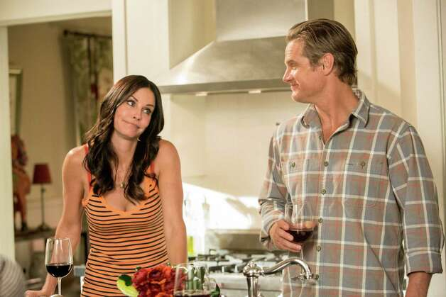 "This undated image released by TBS shows Courteney Cox, left, and Brian Van Holt in a scene from the fourth season of ""Cougar Town,"" premiering Tuesday, Jan. 8, 2013 at 10p.m. EST on TBS. (AP Photo/TBS, Danny Feld) Photo: Danny Feld"