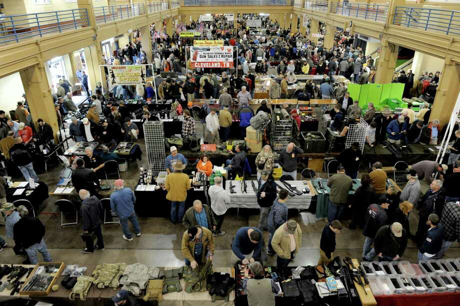 "Owners and promoters of Texas gun shows, similar to this one in Tennessee, said that going after the so-called ""gun show loophole"" will not stop criminals. Photo: Michael Patrick, Associated Press / Knoxville News Sentinel"