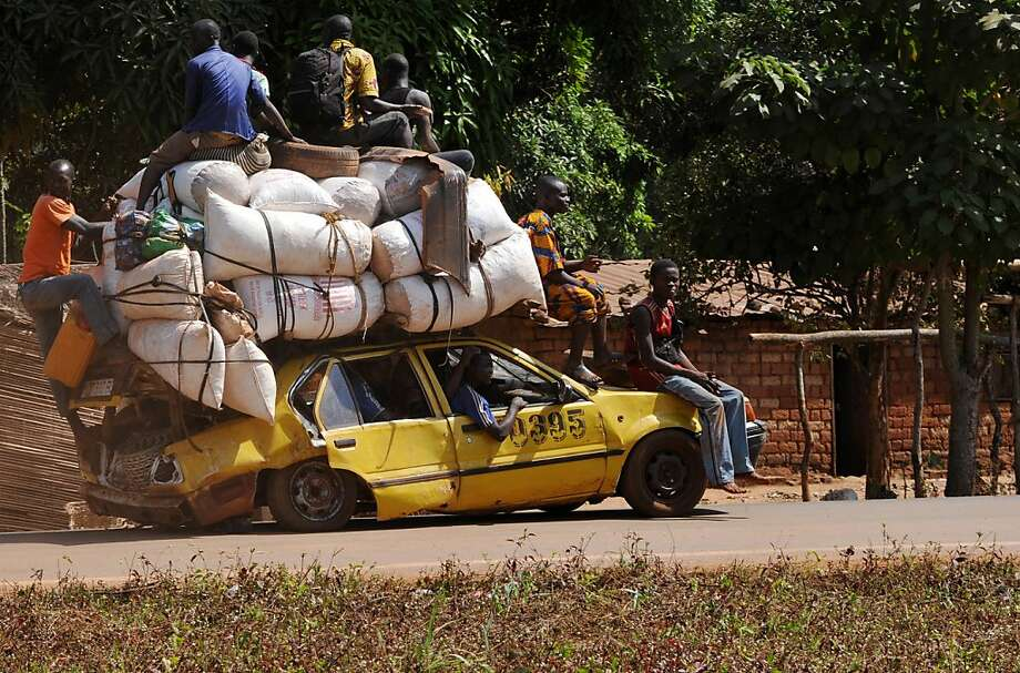 Flat-rate fare:Civilians flee Damara, the last strategic town between rebels and the Central African Republic's capital of Bangui, in a taxi that looks like it couldn't travel 100 yards. The rebels accuse leader Francois Bozize of failing to honor a 2007 peace deal. Photo: Sia Kambou, AFP/Getty Images