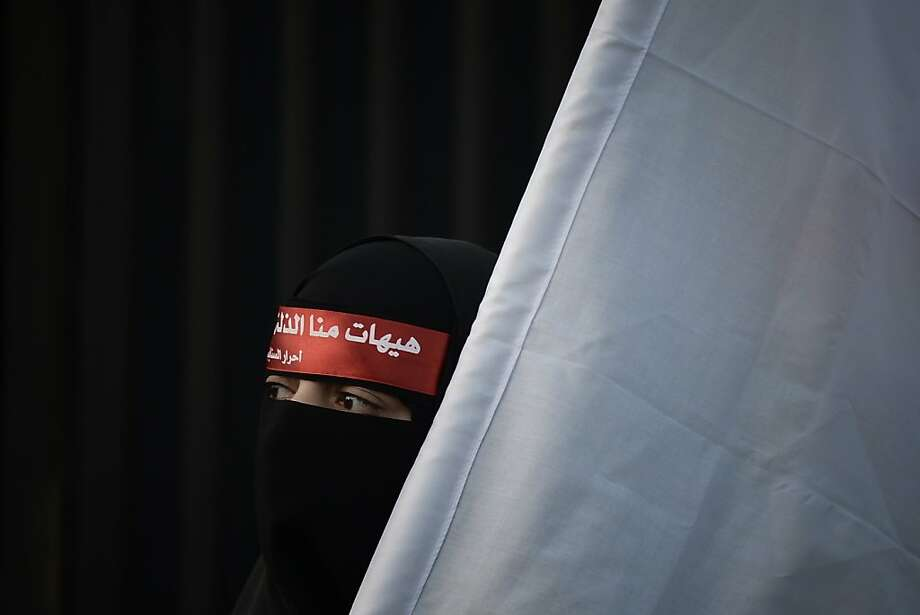 Disembodied head No. 2: A Shiite Muslim woman attends the Arbaeen religious festival in the village of Sanabis, Bahrain. The holiday marks the 40th day after Ashura, commemorating the 7th-century killing of Prophet Mohammed's grandson, Imam Hussein. Photo: Mohammed Al-Shaikh, AFP/Getty Images