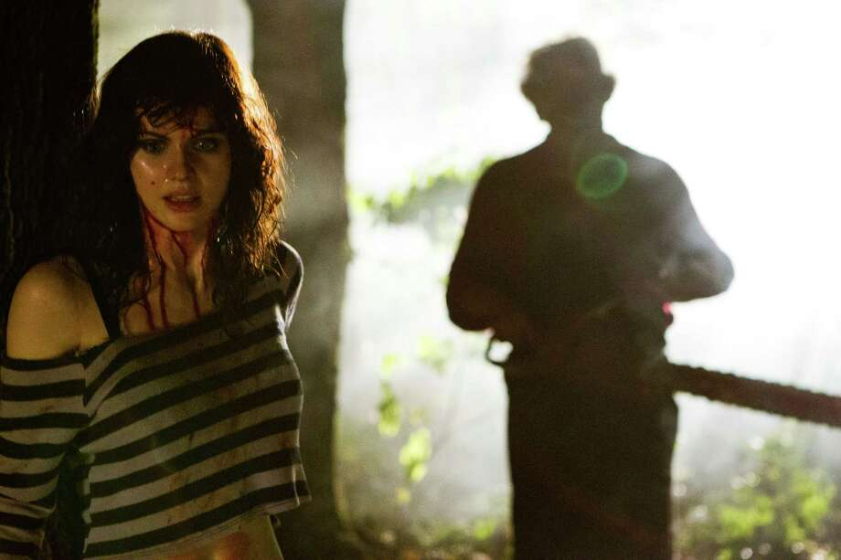 "This undated publicity film image from Lionsgate shows Alexandra Daddario, left, as Heather Miller in a scene from ""Texas Chainsaw 3-D,"" releasing in theaters on Friday, January 4, 2013.  (AP Photo/Lionsgate, Justin Lubin) Photo: Justin Lubin"