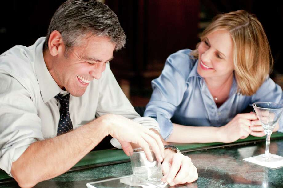 """In this film publicity image released by Paramount, George Clooney, left, and Vera Farmiga are shown in a scene from """"Up in the Air.""""  The film was nominated Tuesday, Feb. 2, 2010 for an Oscar for best picture. The 82nd Academy Awards will be presented on March 7. (AP Photo/Paramount Pictures, Dale Robinette) Photo: Dale Robinette / Paramount Pictures"""