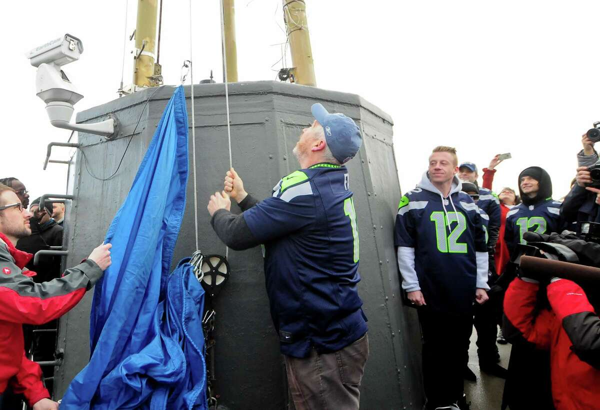 Being mayor means you get a turn to raise the 12th man flag on the Space Needle.