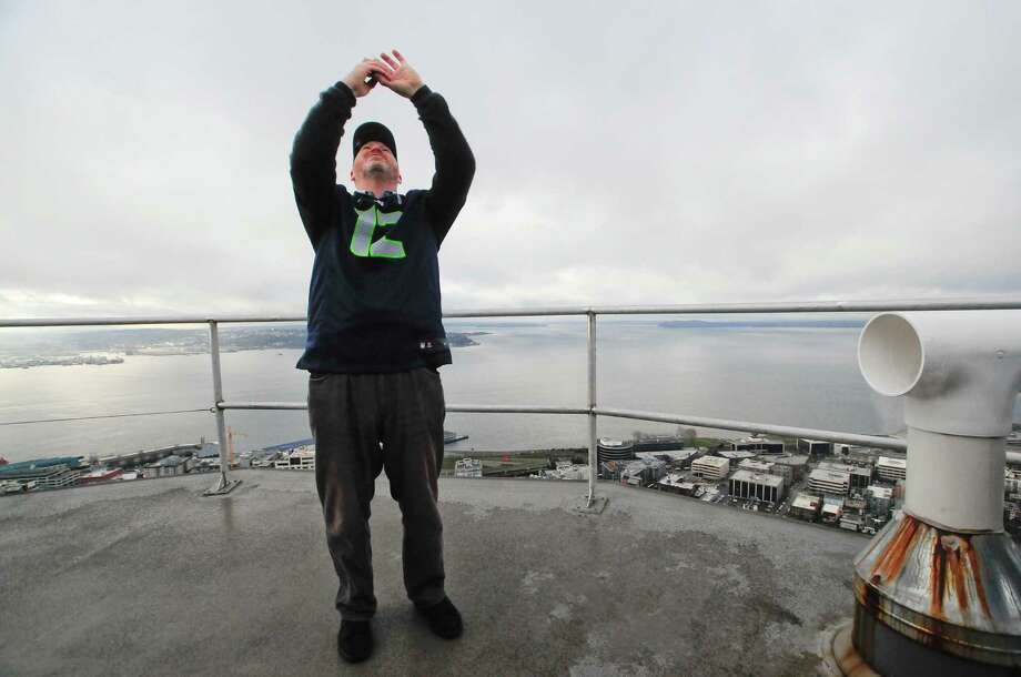 Mayor Mike McGinn takes a photo of the 12th man flag.  Photo: LINDSEY WASSON, Seattlepi.com / SEATTLEPI.COM
