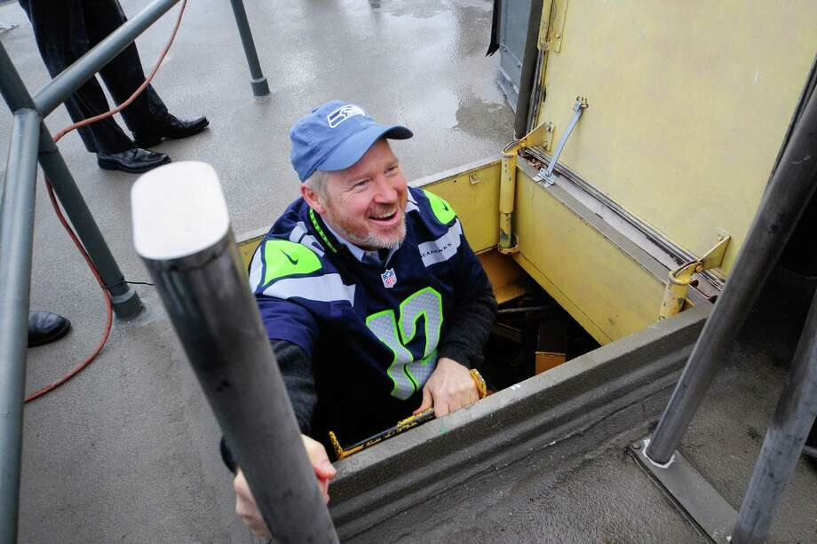 Mayor Mike McGinn smiles as he reaches the roof of the Space Needle where the Seahawks' 12th man flag was raised Friday. The team will face the Washington Redskins in the playoffs on Sunday. (Photo by Lindsey Wasson) Photo: LINDSEY WASSON, Seattlepi.com / SEATTLEPI.COM