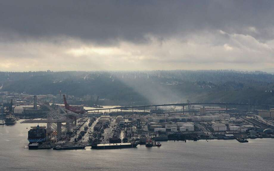 From the Space Needle, you could see the clouds break over Harbor Island as the 12th man flag was raised.  (Photo by Lindsey Wasson) Photo: LINDSEY WASSON, Seattlepi.com / SEATTLEPI.COM