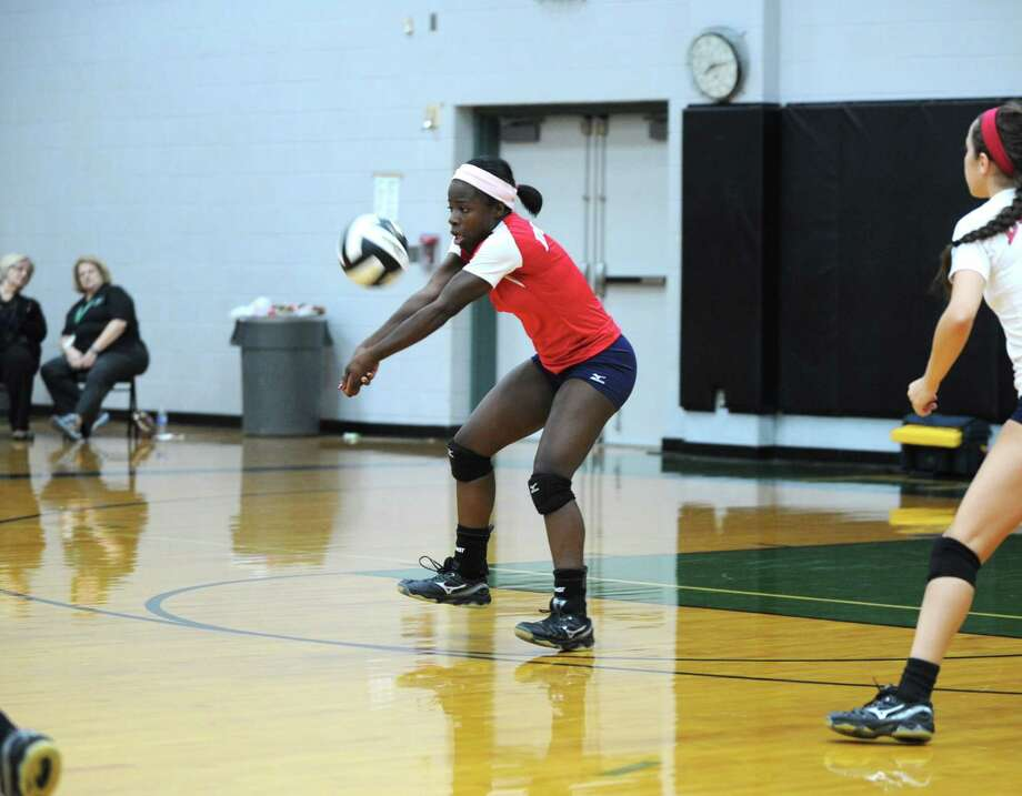 Aki AitsebaomoMiddle blocker/outside hitter, Dulles Photo: Eddy Matchette, For The Chronicle / Freelance