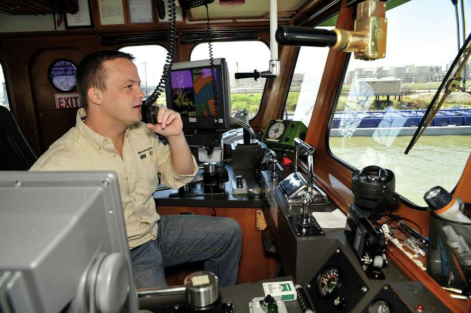 Higman Barge Company Captain Rick Nichols pilots a towboat along the Houston Ship Channel. San Jacinto College offers training for those interested in working in the maritime industry.