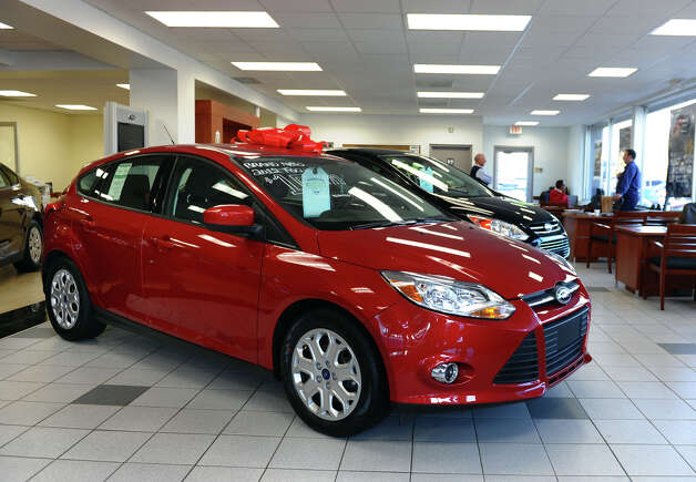 A new Ford Focus sits in the showroom with other new vehicles for sale at Park City Ford in Bridgeport, Conn. on Friday January 4, 2013. American care sales overall in 2012 have seen the best increase in five years. Photo: Christian Abraham