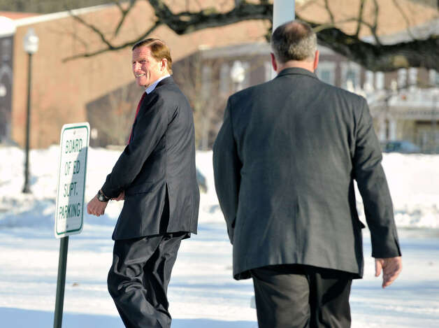 Sen. Richard Blumenthal, left, enters Newtown Town Hall at Fairfield Hills Campus to meet with former Congresswoman Gabrielle Giffords and Newtown First Selectman Pat Llodra among other officials on Friday, Jan. 4, 2013. Photo: Jason Rearick / The News-Times
