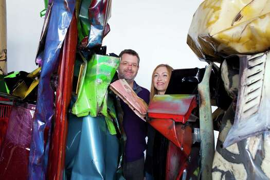 Brad Epley, chief conservator, left, and Shelley M. Smith, sculpture conservator, stand next to a John Chamberlain sculpture at The Menil Collection Dec. 20, 2012 in Houston. Photo: Eric Kayne / © 2012 Eric Kayne