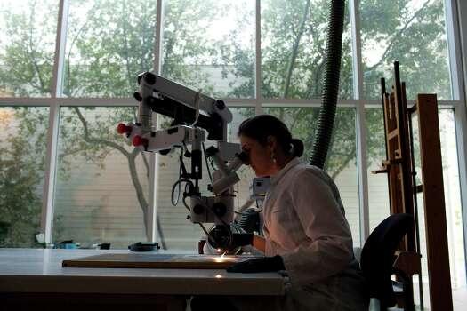 Erin Stephenson, the Menil's Andrew W. Mellon fellow in painting conservation, at work. Photo: Eric Kayne / © 2012 Eric Kayne