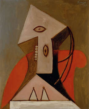 """Pablo Picasso painted """"Woman in a Red Armchair"""" in 1929. A vandal damaged the work in June at the Menil, where it underwent several months of restoration. Photo: Hickey-Robertson / handout"""