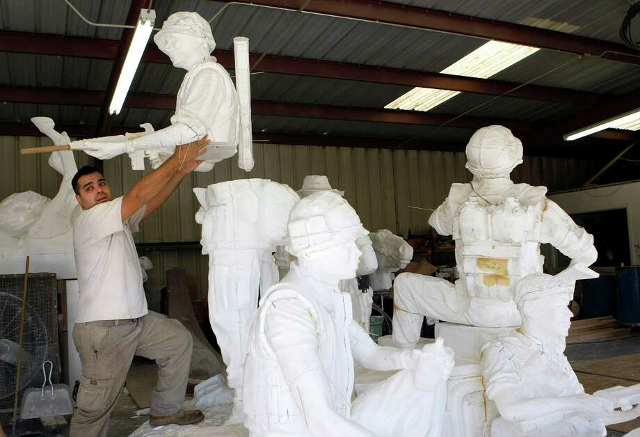 Lonnie Dunkin assembles the larger than life foam milled cutouts of soldiers that were created from a scaled down version of sculptor Duke Sundt's Texas Capitol Vietnam Veterans Monument at the Deep in the Heart Art Foundry  Wednesday, Nov. 7, 2012, in Bastrop. 