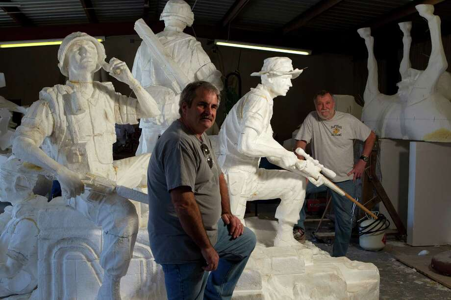 Vietnam veterans, James Hart, 63, left, and Don Dorsey, 66, right stand next to foam cutouts they modeled for sculptor Duke Sundt to get the positioning and stance for the future Texas Capitol Vietnam Veterans Monument at the Deep in the Heart Art Foundry  Wednesday, Nov. 7, 2012, in Bastrop. 