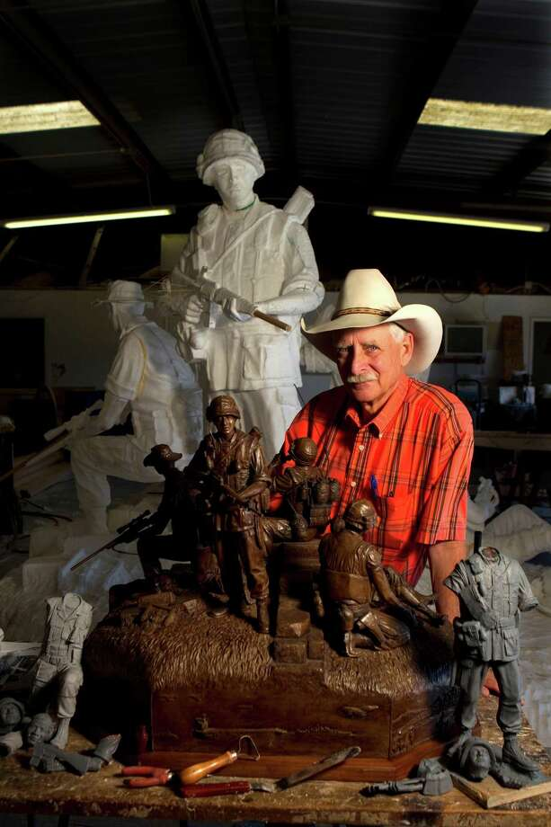 Sculptor Duke Sundt stands next to the maquette of the future Texas Capitol Vietnam Veterans Monument with the full-scale foam milled cutouts of the monument behind him at the Deep in the Heart Art Foundry  Wednesday, Nov. 7, 2012, in Bastrop.  In May 2005, Senator Juan Hinojosa and State Rep. Wayne Smith sponsored a resolution authorizing the Vietnam War monument on the Texas Capitol grounds.  The 14-foot high 2.5 ton bronze sculpture will stand as a permanent reminder of the 3,400 Texans that died while serving in Vietnam as well as the 107 Texas men who went missing in action.  ( Johnny Hanson / Houston Chronicle ) Photo: Johnny Hanson, Houston Chronicle / © 2012  Houston Chronicle
