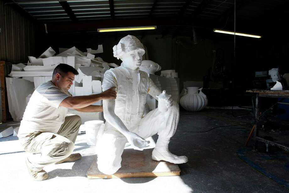 Lonnie Dunkin assembles the larger than life foam milled cutout of a soldier that was created from a scaled down version of sculptor Duke Sundt's Texas Capitol Vietnam Veterans Monument at the Deep in the Heart Art Foundry  Wednesday, Nov. 7, 2012, in Bastrop.  The foam cutouts will be used to help make the mold for the casting. In May 2005, Senator Juan Hinojosa and State Rep. Wayne Smith sponsored a resolution authorizing the Vietnam War monument on the Texas Capitol grounds. The 14-foot high 2.5 ton bronze sculpture will stand as a permanent reminder of the 3,400 Texans that died while serving in Vietnam as well as the 107 Texas men who went missing in action. ( Johnny Hanson / Houston Chronicle ) Photo: Johnny Hanson, Houston Chronicle / © 2012  Houston Chronicle