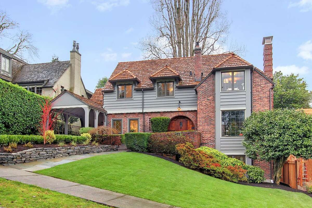 Did you resolve to buy a grand old home for New Year's? How about this updated 1931 Paul Thiry Brick Tudor in Denny Blaine, 321 36th Ave. E.? The 3,250-square-foot house has four bedrooms, 3.25 bathrooms, tons of dark-stained wood, beamed ceilings, French doors, leaded glass, skylights, a lower-level nanny quarters with a fireplace and kitchen, and a terraced yard with two patios on a 5,799-square-foot lot. It's listed for $1.195 million.