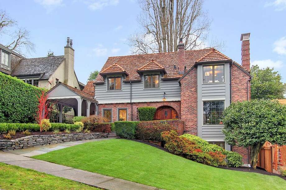 Did you resolve to buy a grand old home for New Year's? How about this updated 1931 Paul Thiry Brick Tudor in Denny Blaine, 321 36th Ave. E.? The 3,250-square-foot house has four bedrooms, 3.25 bathrooms, tons of dark-stained wood, beamed ceilings, French doors, leaded glass, skylights, a lower-level nanny quarters with a fireplace and kitchen, and a terraced yard with two patios on a 5,799-square-foot lot. It's listed for $1.195 million. Photo: Courtesy Michael Ravenscroft/Windermere Real Estate