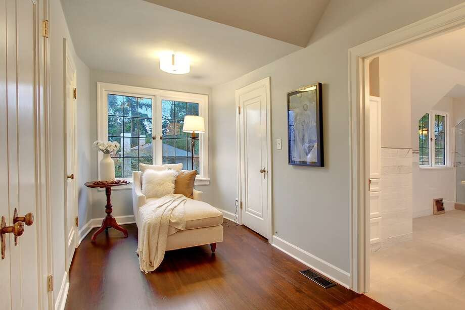 Master suite of 321 36th Ave. E. The 3,250-square-foot house, built in 1931, has four bedrooms, 3.25 bathrooms, tons of dark-stained wood, beamed ceilings, French doors, leaded glass, skylights, a lower-level nanny quarters with a fireplace and kitchen, and a terraced yard with two patios on a 5,799-square-foot lot. It's listed for $1.195 million. Photo: Courtesy Michael Ravenscroft/Windermere Real Estate