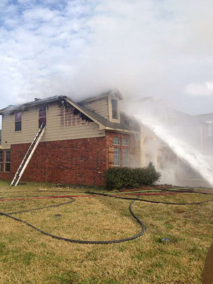 Montgomery County firefighters battled a stubborn chimney fire Friday afternoon that damaged a home on Carson Ridge Drive at Rayford Crest Drive. No injuries were reported. Photo: Montgomery County Fire Marshal