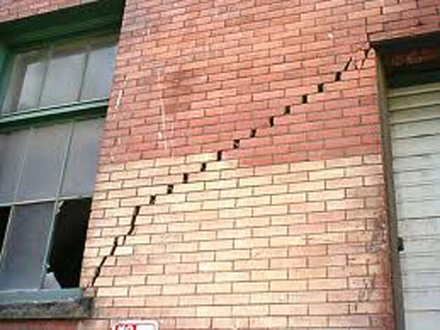 A crack in a brick wall is a sign of foundation damage. Photo: Courtesy Of Du-West Inc.