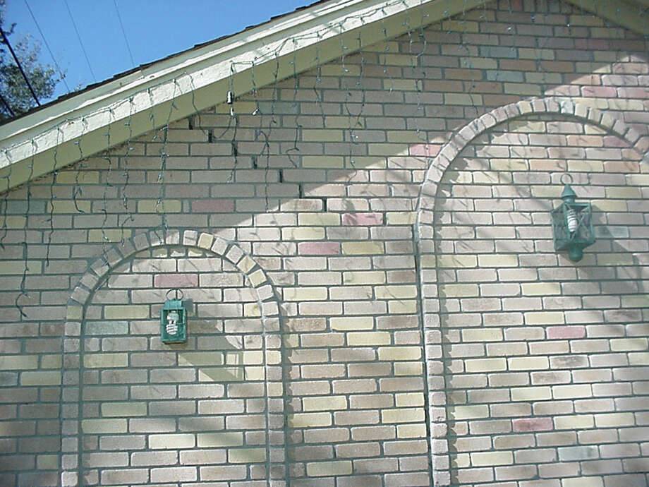 Cracks in brick walls are signs of foundation problems that can be repaired. Photo: Courtesy Of Olshan Foundation So