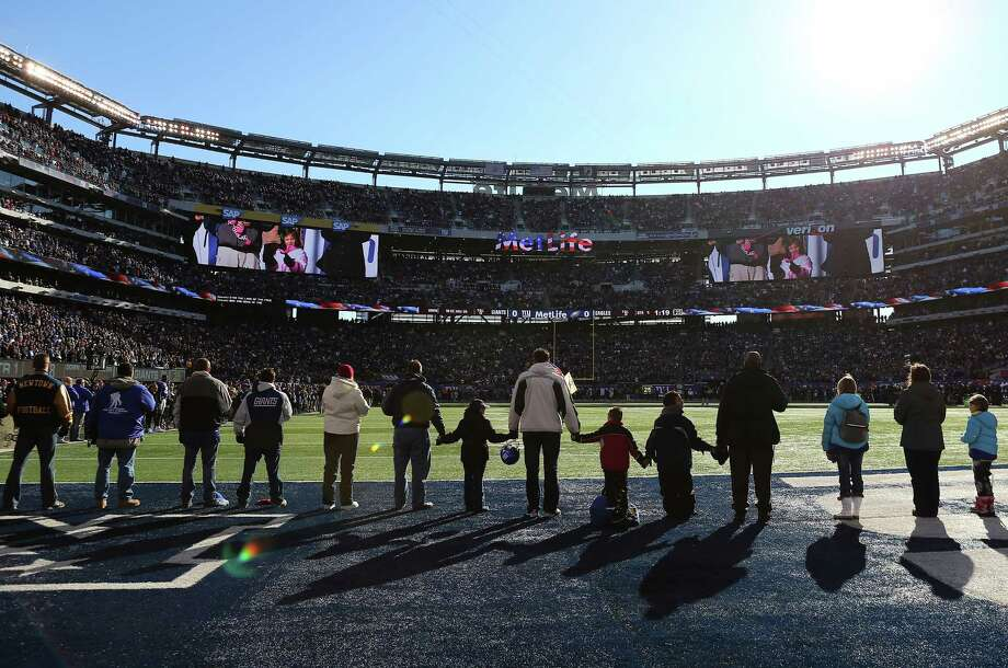 Families from Sandy Hook Elementary School in Newtown, Conn., surround the field during the national anthem before a New York Giants game on Dec. 30. Photo: Elsa, Staff / 2012 Getty Images